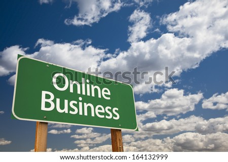 Online Business Green Road Sign with Dramatic Clouds and Sky.