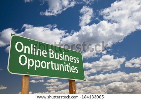 Online Business Opportunities Green Road Sign with Dramatic Clouds and Sky. - stock photo