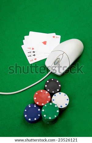 Online casino concept with mouse, cards and casino chips - stock photo