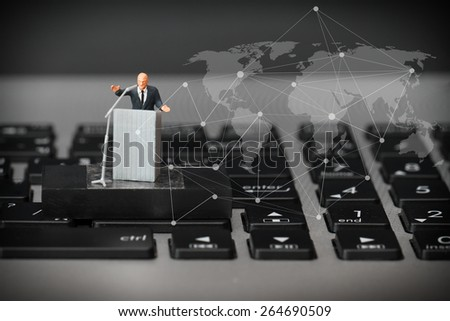 online conference concept-miniature speaker at Business Conference on laptop computer with social network diagram - stock photo