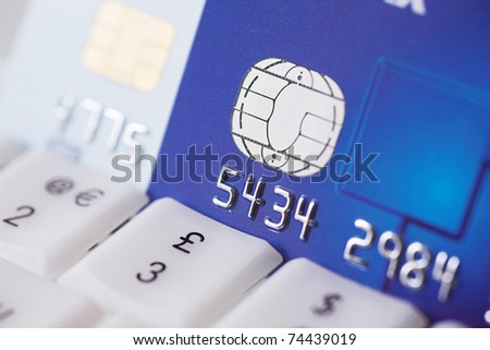 Online credit transaction - shallow dof - stock photo