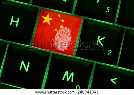 Online crime scene with a finger print left on backlit keyboard with Chinese flag on it - stock photo
