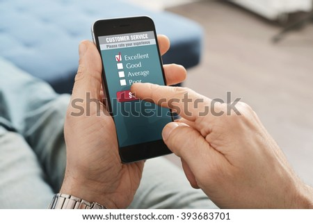 Online customer service satisfaction survey on a mobile phone - stock photo