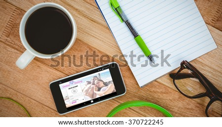 Online dating app against view of a business desk - stock photo