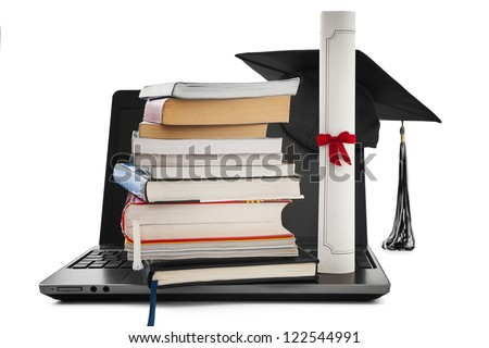 Online education -Books, diploma and graduation cap on a laptop - stock photo