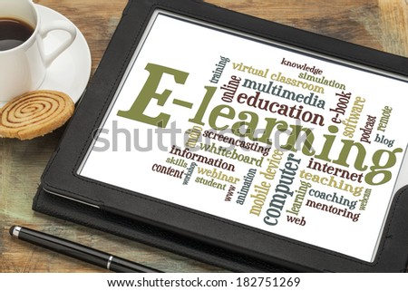 online education concept - e-learning word cloud on a digital tablet with a cup of coffee - stock photo