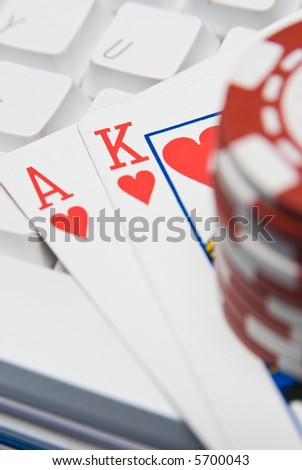 Online gambling with an ace and a king with a keybaord and chips - stock photo