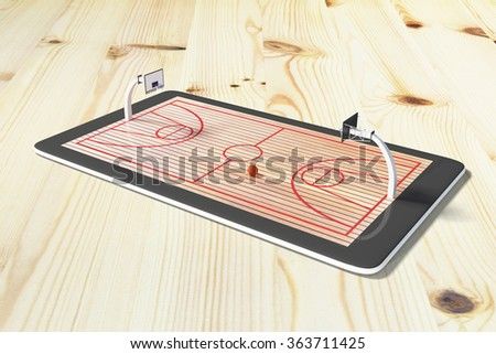 Online game concept with digital tablet on wooden table and basketball field  - stock photo