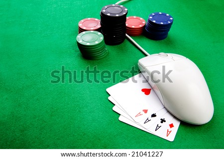 Online gaming and gambling concept, green felt, a mouse and cards - stock photo