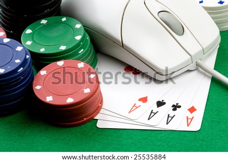 Online gaming and gambling concept, green felt, a mouse, cards and casino chips