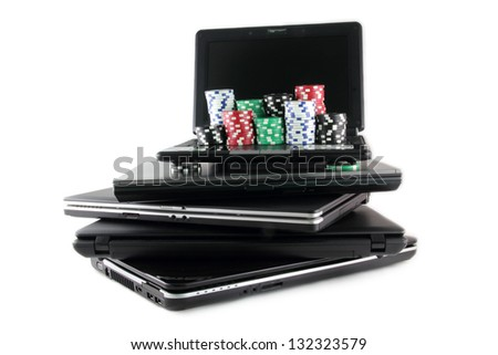 Online gaming and gambling concept, laptop and casino chips on keyboard - stock photo