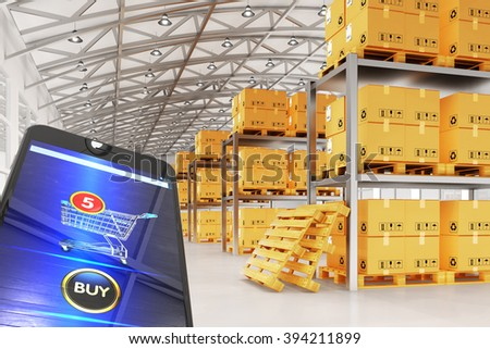 Online internet purchases and e-commerce concept, modern mobile phone with shopping cart and buy button on the screen and background with warehouse interior with packages and boxes on pallets - stock photo