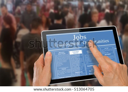 Online job hunting Hands with computer tablet reading employment ads in front of crowd of people