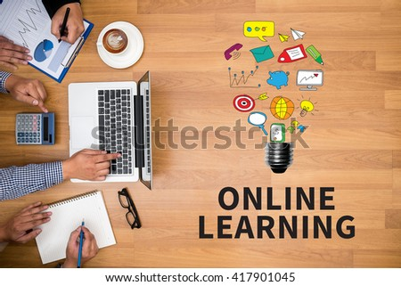 ONLINE LEARNING Business team hands at work with financial reports and a laptop - stock photo