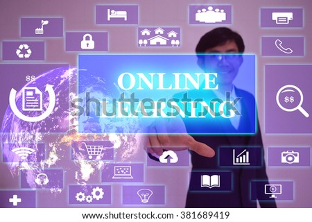 ONLINE LEARNING  concept  presented by  businessman touching on  virtual  screen ,image element furnished by NASA - stock photo