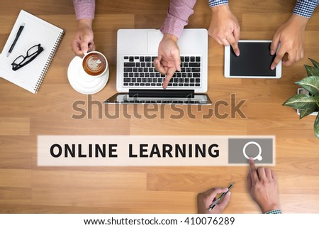 ONLINE LEARNING man touch bar search and Two Businessman working at office desk and using a digital touch screen tablet and use computer objects on the right, top view - stock photo