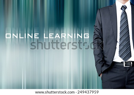 ONLINE LEARNING sign on blur background with standing businessman - stock photo