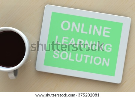 ONLINE LEARNING SOLUTION, message on tablet and coffee on table - stock photo