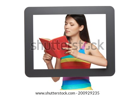 Online library concept. Young woman reading a book through tablet frame, over white background - stock photo