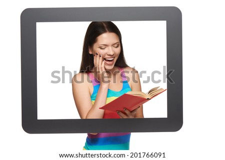 Online library / learning concept. Happy young woman reading a book through tablet frame, over white background - stock photo