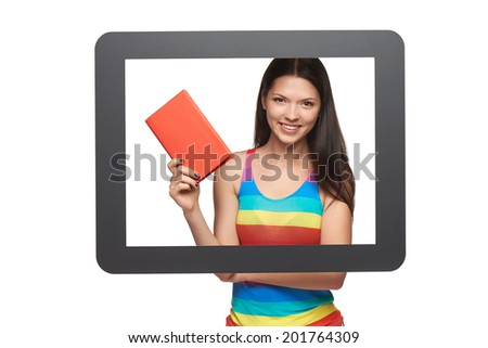 Online library / learning concept. Happy young woman showing a book through tablet frame, over white background - stock photo