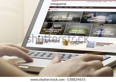 online magazine concept: man using a laptop with online magazine on the screen. Screen graphics are made up.
