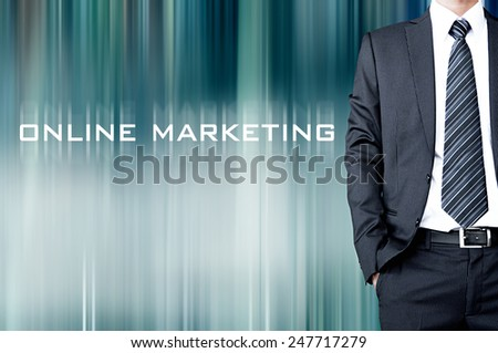 ONLINE MARKETING sign on motion blur abstract background with standing businessman - stock photo
