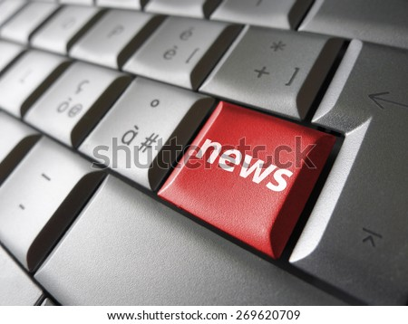 Online news Internet concept with news sign and symbol on a red laptop computer key for blog, website and online business. - stock photo