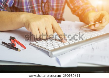 Online payment,Man's hands holding a credit card and using laptop for online shopping,Business Man holding a credit card and typing. On-line shopping on the internet using a laptop,selective focus - stock photo