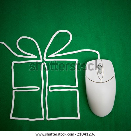 Online present shopping concept, mouse on green background with present - stock photo