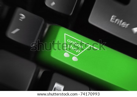 Online shop -The button for purchases on the keyboard - stock photo