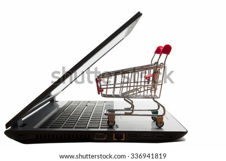 Online shopping concept - Empty Shopping Cart on laptop isolated on white background. Copy space for text