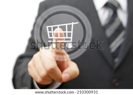 Online shopping  concept with businessman touching virtual shopping cart - stock photo