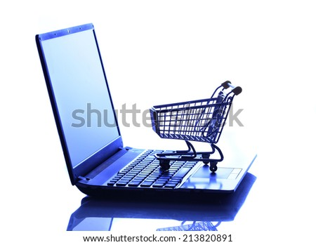 Online shopping e-commerce shopping cart with notebook - stock photo