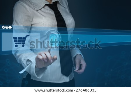Online Shopping - Finger Pushing Add To Basket Button On Touchscreen - stock photo