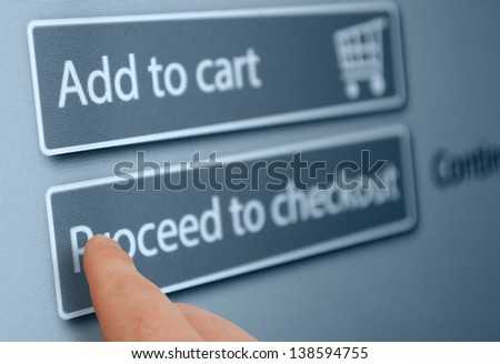Online Shopping - Finger Pushing Add To Cart Button On Touchscreen - stock photo