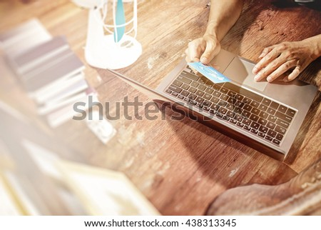 Online shopping.Hands holding credit card and using laptop. - stock photo