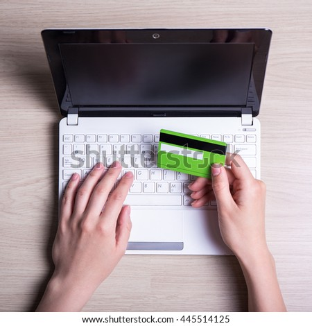 online shopping - laptop and female hands with credit card