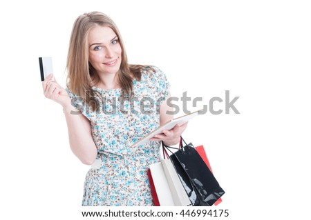 Online shopping payment concept with young shopper browsing on modern tablet isolated on white background - stock photo