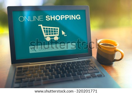 Online shopping searching products from internet with laptop on table - stock photo