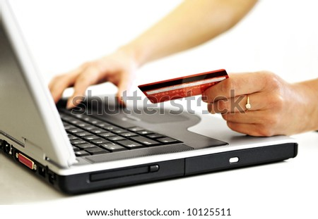 Online Shopping. Very shallow DOF! Focus on the hand and on the card. - stock photo
