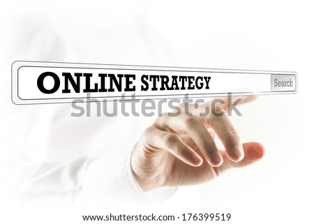 Online strategy written in a navigation bar on a virtual interface or computer screen with a businessman reaching out his finger to activate the search button from behind. - stock photo