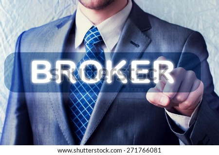Online trading concept. Businessman pressing a Broker button on virtual screen - stock photo