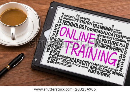 online training concept with related word cloud handwritten on tablet pc - stock photo