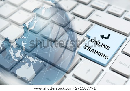 Online training enter key and glass globe over white computer keyboard  - stock photo