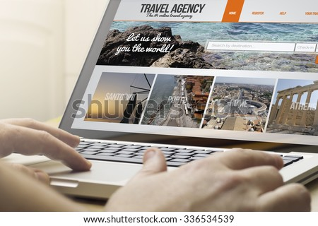 online travel concept: man using a laptop with travel agency on the screen. Screen graphics are made up. - stock photo