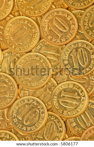 Only golden coins of ten close up - stock photo