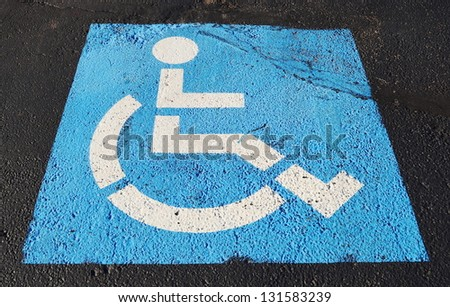 only handicapped parking sign on the asphalt ground - stock photo