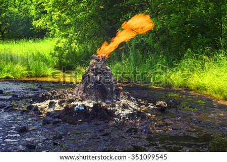 Only in the Carpathians active mud (clay and bitumen) volcano on the outskirts of the village Starunov. Formed in 1977 on the site of an old oil field after the earthquake in Romania. - stock photo