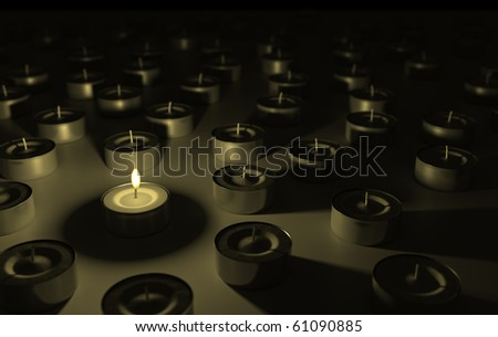 Only one lit candle stands out from the crowd. - stock photo